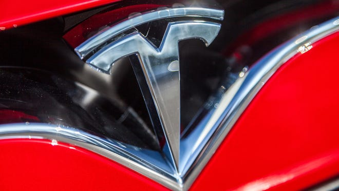 Tesla Inc. added Larry Ellison and Kathleen Wilson-Thompson to its board of directors Friday, fulfilling the terms of the settlement reached with U.S. securities regulators over its CEO's problematic posts about taking the company private.