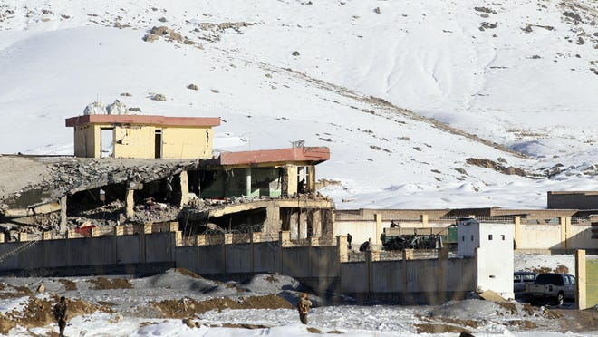 In this Jan. 21, 2019 file photo, Afghan security forces inspect the site of a Taliban attack in Maidan Shar, capital of Maidan Wardak province, east of Kabul, Afghanistan. The Taliban launched a pre-dawn attack on an army base in northern Afghanistan on Feb. 5, 2019, killing 26 members of the security forces, a provincial official said, the latest brazen assault by insurgents to defy stepped-up efforts to resolve the country's protracted war.