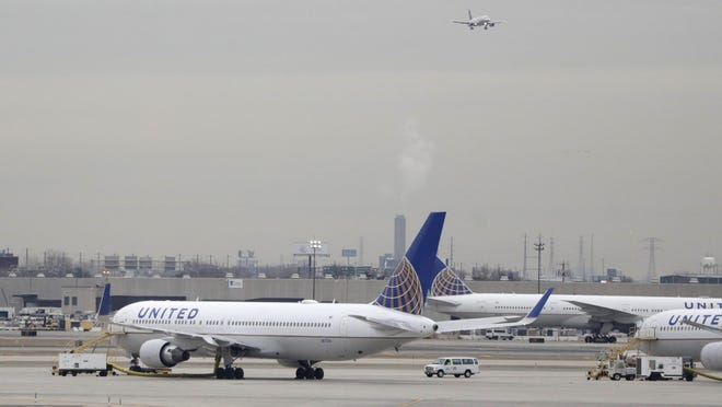 United Airlines jets are seen as a plane approaches Newark Liberty International Airport, in Newark, N.J., in this file photo. Federal authorities on March 11, 2019, say a United Airlines flight declared an emergency when an engine shut down as the plane descended into Houston.