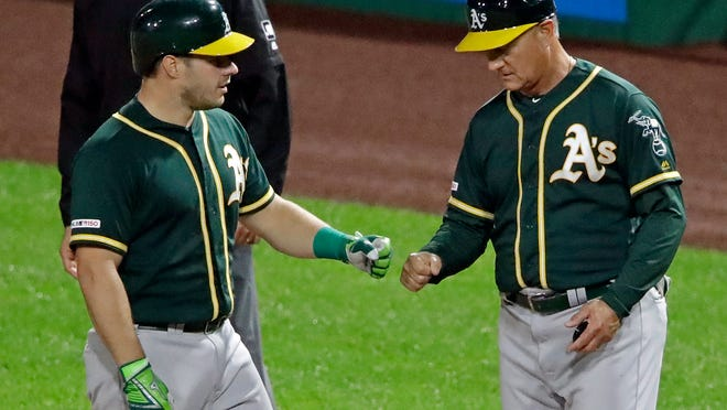Al Pedrique, right, served on the Oakland A's coaching staff from 2018 to 2020. The Jacksonville Jumbo Shrimp named Pedrique as manager on Monday.