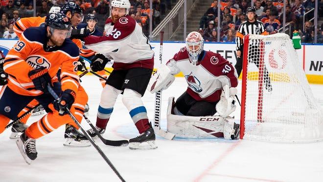 Edmonton Oilers' Leon Draisaitl (29) looksto shoot against Colorado Avalanche goaltender Adam Werner (30) during second-period NHL hockey game in Edmonton, Alberta, Thursday, Nov. 14, 2019. (Codie McLachlan/The Canadian Press via AP)