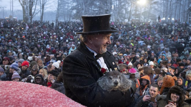 Groundhog Club co-handler John Griffiths holds Punxsutawney Phil, the weather prognosticating groundhog, during the 134th celebration of Groundhog Day on Gobbler's Knob in Punxsutawney, Pa. Sunday, Feb. 2, 2020. Phil's handlers said that the groundhog has forecast an early spring. (AP Photo/Barry Reeger)