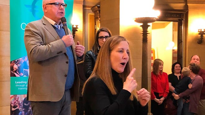 """With the aid of a sign-language interpreter, Minnesota Gov. Tim Walz speaks to about 100 LGBTQ activists and their supporters Friday in Minneapolis as he urges lawmakers to pass a ban on """"conversion therapy"""" for minors."""