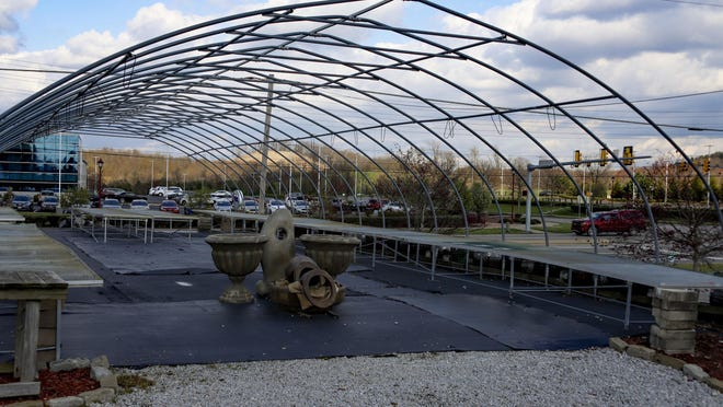 "Empty tables for garden plants are under the framework for a greenhouse, Friday, April 24, 2020, in Cranberry Township. Some garden centers remain shuttered under Wolf's statewide March 19 order for ""non-life-sustaining"" businesses to close. Nurseries and greenhouses are allowed to remain open and selling, while garden center owners complain that big-box stores, farming supply stores or competitors that sell farm supplies, building materials or other qualifying goods can stay open and sell gardening supplies. (AP Photo/Keith Srakocic)"