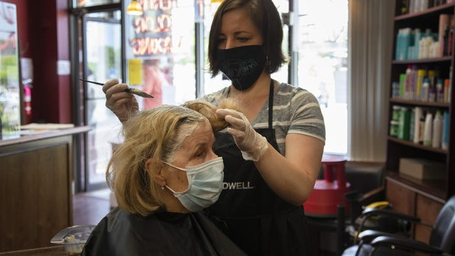 After waiting since February, Cathy Coniglio gets her hair done by stylist Alyse Beers at Vincent of Warwick Hair Salon, which reopened on Tuesday as part of the COVID-19 Hudson Valley Phase 2.