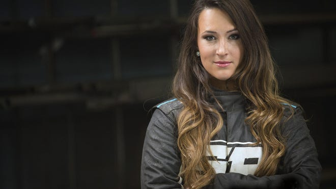 Former X-Games medalist Sara Price is ready for a starring role in a new electric SUV off-road racing series scheduled to begin in 2021. Price is ready to debut as the first female driver in any racing series for IndyCar and NASCAR team owner Chip Ganassi. ASSOCIATED PRESS