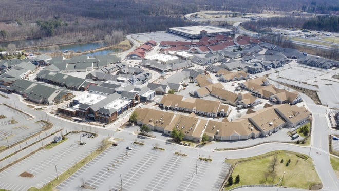 Parking lots are empty Sunday at Woodbury Common Premium Outlets, which has closed during the coronavirus pandemic.