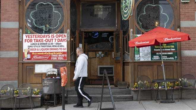 Yesterday's Irish Pub, along Main Street in Warwick, has a large open for takeout sign on Friday.