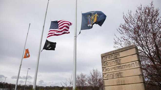 Flags are flown at half-mast at the Orange County Government Center in Goshen on Thursday. Gov. Andrew Cuomo directed flags to be flown at half-mast in honor of those who have died during the coronavirus crisis.