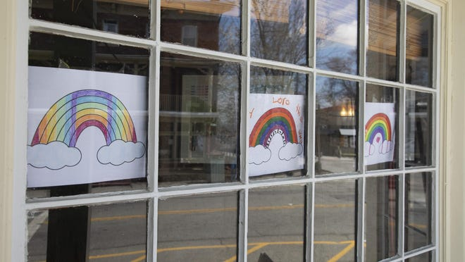 Rainbows are displayed in the front windows of Cafe a la Mode in Warwick.