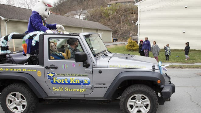 The Easter Bunny made his way through the streets of Port Jervis escorted by a Port Jervis police car and fire truck Friday afternoon as children and parents waved from street corners and sidewalks while keeping social distance. To see more photos of the Easter Bunny, go to recordonline.com.