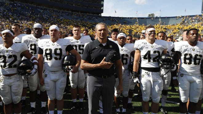 Army football head coach Jeff Monken stands with his team, singing after the game against Michigan on Sept. 7, 2019 in Ann Arbor, Mich. Michigan won 24-21 in double-overtime. The past three seasons, Army's schedule has been aimed at securing one Top 10 opponent. In 2020, Army finally gets to host its top opportunity at a prime résumé-builder when Oklahoma visits on Sept. 26.