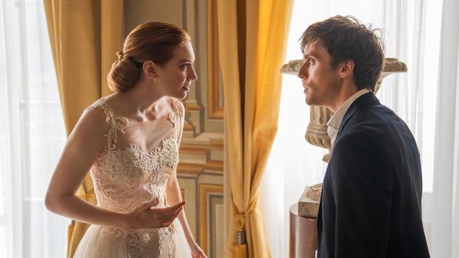 "Sam Claflin, right, and Eleanor Tomlinson in ""Love. Wedding. Repeat."""
