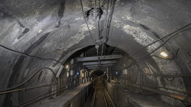 FILE - This Oct. 17, 2018 file photo shows damage to the Hudson River rail tunnel in New York. The news that Amtrak is working with federal officials to do extensive repairs to its Hudson River rail tunnel while a plan to build a new tunnel languishes raises the specter of more delays for already beleaguered commuters.  Transportation Secretary Elaine Chao told a House subcommittee Thursday, Feb. 27, 2020,  that the work needs to happen now instead of waiting for a new tunnel to be built,