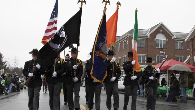 Orange County Sheriff's officers march in last year's Mid-Hudson St. Patrick's Day Parade in Goshen. This year's parade has been postponed to September.