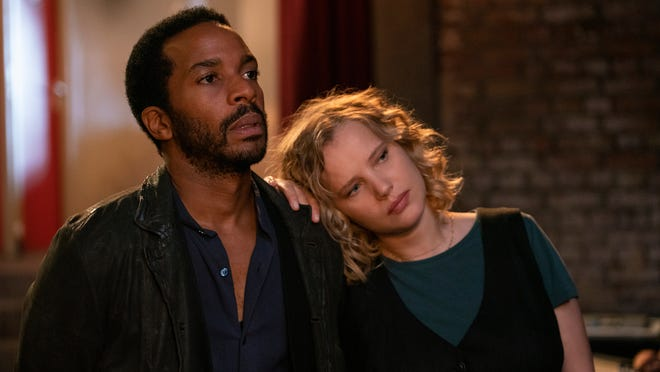 """This image shows Andre Holland, left, and Joanna Kulig in a scene from """"The Eddy."""""""