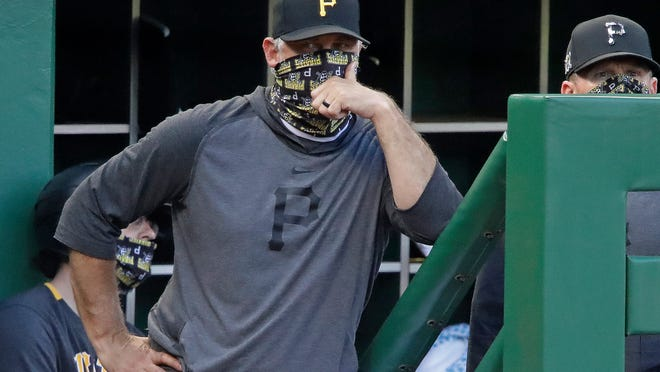 In this July 22, 2020, file photo, Pittsburgh Pirates manager Derek Shelton stands on the dugout steps during an exhibition baseball game against the Cleveland Indians in Pittsburgh. Shelton is entering his second year as the Pirates' manager.