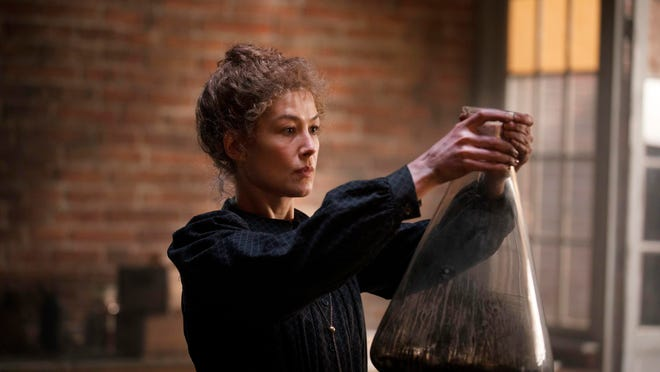 """Rosamund Pike as Marie Curie in a scene from """"Radioactive."""""""