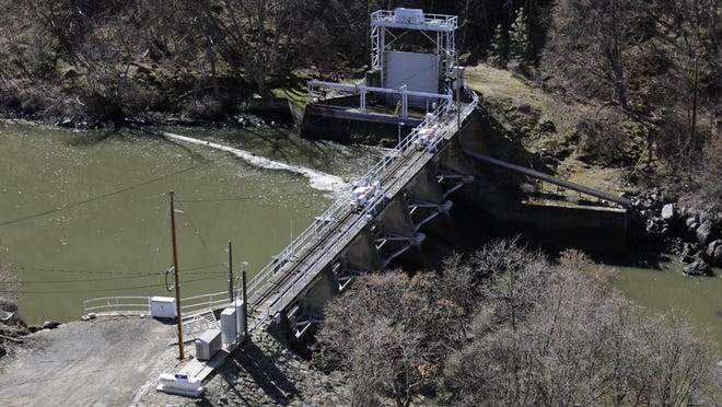 FILE - In this March 3, 2020, file photo, a dam on the lower Klamath River known as Copco 2 is seen near Hornbrook, Calif. The Federal Energy Regulatory Commission on Thursday, July 16, 2020, threw a significant curveball at a coalition that has been planning for years to demolish four massive hydroelectric dams on a river along the Oregon-California border to save salmon. The project, if it goes forward, would be the largest dam demolition project in U.S. history and would include the Copco 2 facility pictured.