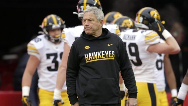 Iowa head coach Kirk Ferentz follows warmups before an NCAA college football game against Nebraska in Lincoln, Neb., Friday, Nov. 29, 2019.