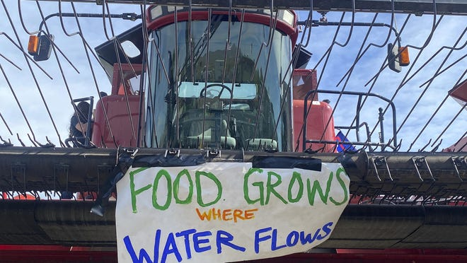 A sign is shown on the front of farm equipment near Merrill on Friday. Farmers upset about water issues planned a convoy in southwest Oregon.