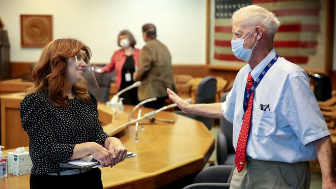 Rep. Christine Drazan, R-Canby, and Senate President Peter Courtney, D-Salem, talk after the Joint Committee on the First Special Session of 2020 took a brief recess at the Oregon State Capitol in Salem on Wednesday.