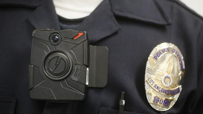 A body camera is shown on a Los Angeles Police officer.