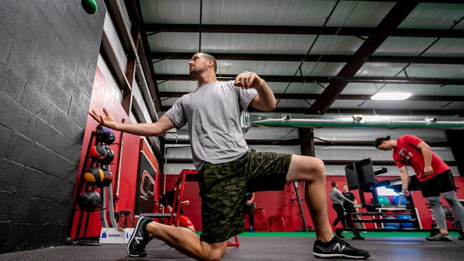 Kevin Shackelford, a free agent pitcher from Palm Beach Gardens, works out at Cressey Sports Performance's 10,000-square-foot, high-performance training facility in Palm Beach Gardens. The facility, which serves amateur, Olympic and professional athletes, opened in December.
