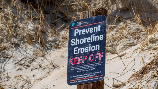 Signs warn visitors to keep off the shoreline surrounding the Jupiter Inlet Lighthouse Outstanding Natural Area in Jupiter on Feb. 12, 2020.