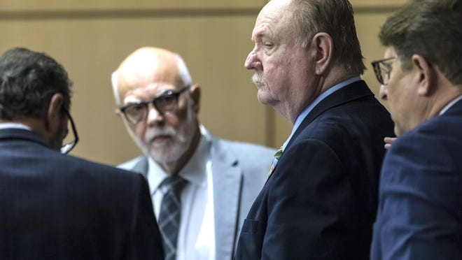 Carlton Nebergall talks with his attorneys after the jury announced they were deadlocked in his trial Thursday in West Palm Beach. Nebergall, a retired Palm Beach County sheriff's deputy, is charged with first-degree murder in the 2018 fatal shooting of his estranged son-in-law, Jacob Lodge.