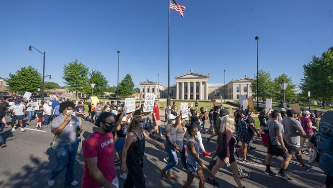 Demonstrators protesting the death of George Floyd marched around the Federal Court House in Tuscaloosa on May 31.