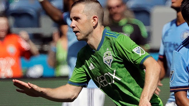 FILE - In this July 29, 2018, file photo, Seattle Sounders midfielder Harry Shipp reacts after scoring a goal against New York City FC during the second half of an MLS soccer match in Seattle. When Major League Soccer and its players came to agreement on a new collective bargaining agreement back in February, there was a genuine feeling of accomplishment on both sides. Those pre-pandemic positive vibes are now gone, at least in how the players feel toward the league and ownership.