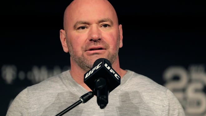 In this Nov. 2, 2018, file photo, UFC president Dana White speaks at a news conference in New York. When White first proposed holding mixed martial arts fights on an isolated island during the early weeks of the worldwide sports shutdown, fans and haters alike imagined waves lapping at an octagon perched amid palm trees on a white sand beach. A few months later, the project that came to be known as Fight Island is real, and ready for competition. And while it's not literally on a beach, the octagon at Abu Dhabi's Yas Island is inside a bubble that seems highly unlikely to burst.