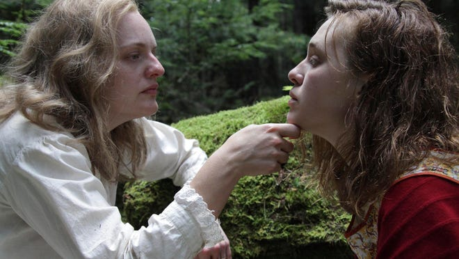 "This image shows Elisabeth Moss, left, and Odessa Young in a scene from ""Shirley."""