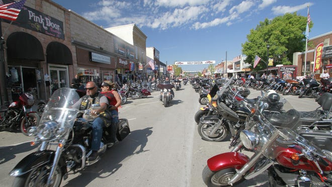 Thousands of bikers rode through the streets for the opening day of the 80th annual Sturgis Motorcycle rally Friday, Aug. 7, 2020, in Sturgis, South Dakota.