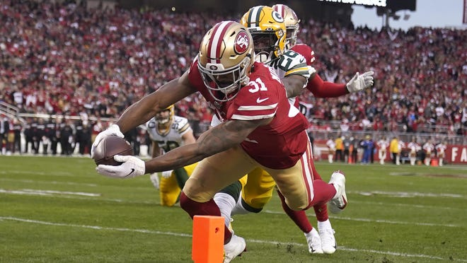San Francisco 49ers running back Raheem Mostert (31), a New Smyrna Beach graduate, rushed for a franchise playoff record 220 yards and four touchdowns in a 31-21 NFC Championship victory over Green Bay.