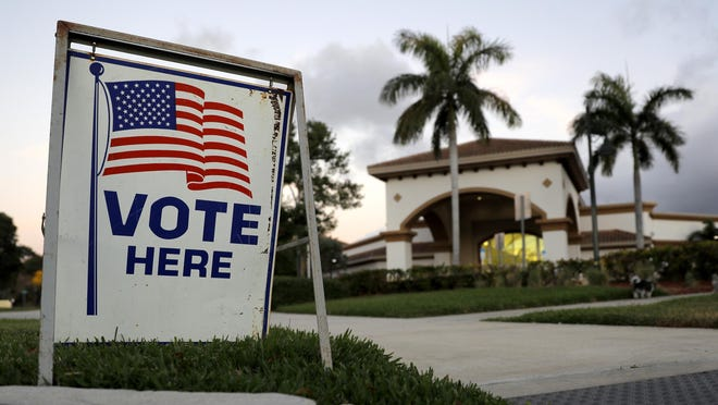 A sign is seen outside a polling place at the Boca Raton Library during the Florida primary election on March 17.