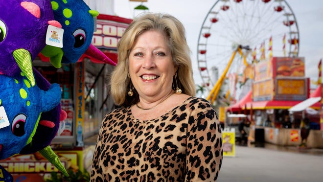 Vicki Chouris, CEO of the South Florida Fair, stands near the midway on Friday in West Palm Beach.