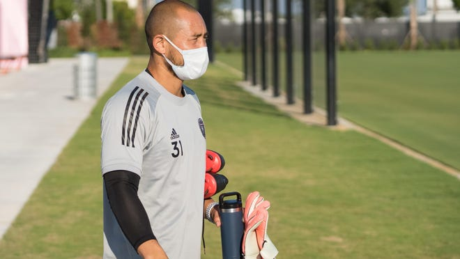Inter Miami CF goalkeeper Luis Robles arrives in a mask during voluntary individual workouts in Fort Lauderdale.