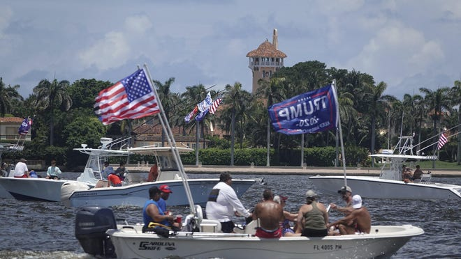 Some of the boats that were part of a Flag Day pro-Trump birthday flotilla pass by Mar-A-Lago in Palm Beach, in Florida Sunday, June 14, 2020.