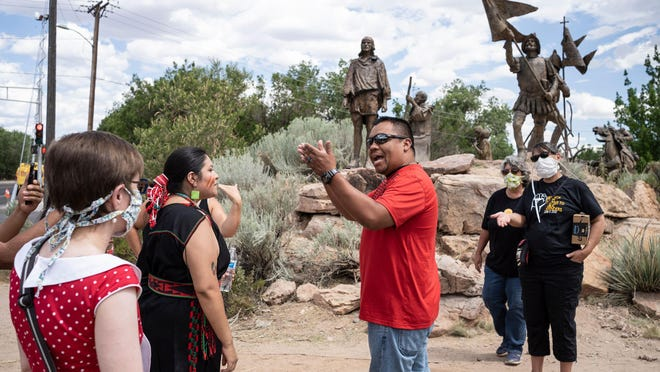 A man who opposed the removal of a statue of conquistador Juan de Onate argues with protesters on June 16 in Albuquerque, N.M., after the sculpture of the conquistador was removed.