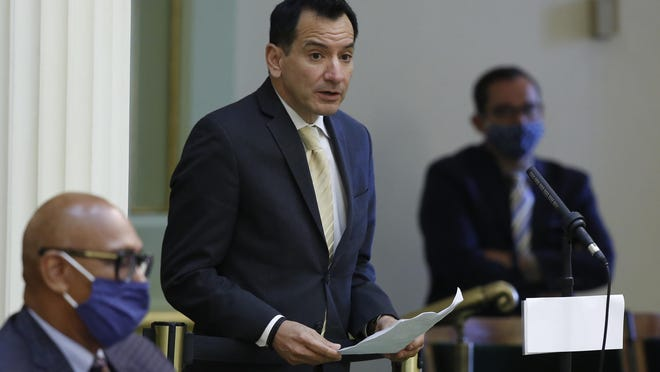 Assembly Speaker Anthony Rendon, D-Lakewood, urges lawmakers to approve the state budget bill at the Capitol in Sacramento in June. Rendon said on Thursday that lawmakers could vote by proxy for the final month of the legislative session. The move comes after a coronavirus outbreak in the legislature sickened at least seven people and put Republican Assemblyman Tom Lackey in the hospital.