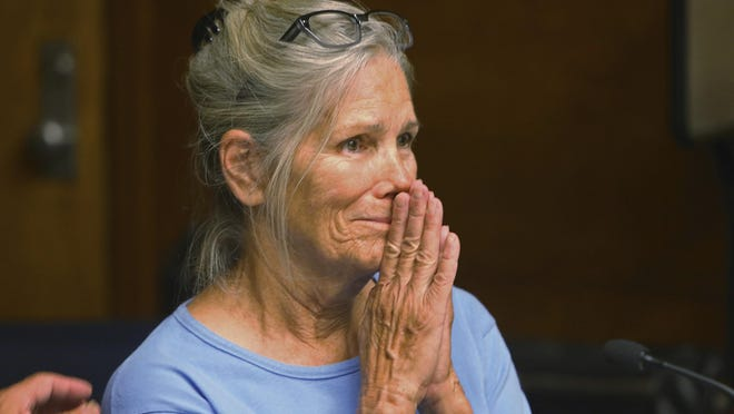 Leslie Van Houten reacts after hearing she is eligible for parole during a hearing at the California Institution for Women in Corona in 2017. A California panel has recommended parole for Van Houten, who has spent nearly five decades in prison, although Gov. Gavin Newsom has the final say.