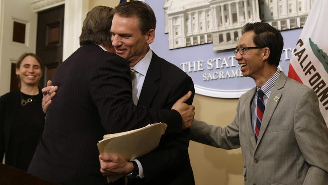 State Sen. Bob Hertzberg, D-Van Nuys, left, and Assemblyman Ed Chau, D-Arcadia, right, celebrate in 2018 with Alastair Mactaggart, center, after the Legislature approved their data privacy bill in Sacramento, Calif. California voters will decide a ballot measure this November that would give them more power over how companies use their data, an extension of a landmark privacy law passed in 2018. Secretary of State Alex Padilla announced Wednesday, June 25, 2020, a measure to amend the law will be on the Nov. 3 general election ballot.