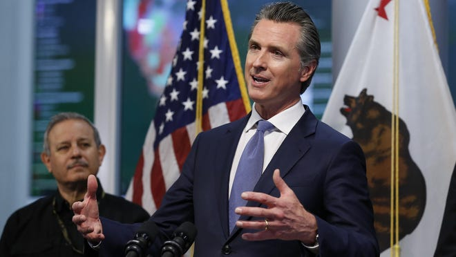 Gov. Gavin Newsom gives an update to the state's response to the coronavirus, at the Governor's Office of Emergency Services in Rancho Cordova on Tuesday, March 17, 2020. On Wednesday, July 1, 2020, Newsom announced increased coronavirus restrictions in 19 counties, including San Bernardino County, in response to spikes in COVID-19 infections and hospitalizations.