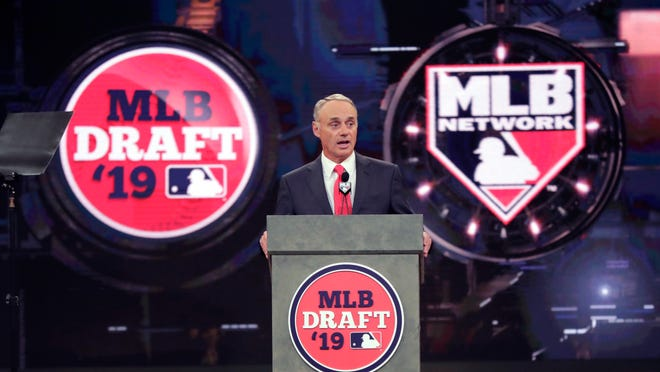 FILE - In this June 3, 2019, file photo, Baseball Commissioner Rob Manfred speaks during the first round of the baseball draft in Secaucus, N.J. Baseball's amateur draft this week will look much different because of the coronavirus pandemic, and more permanent changes could be coming soon.