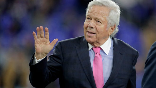 FILE - In this Nov. 3, 2019, file photo, New England Patriots owner Robert Kraft waves to fans as he walks on the field prior to the team's NFL football game against the Baltimore Ravens in Baltimore. Florida prosecutors will try to save their prostitution solicitation case against Kraft when they argue before an appellate court Tuesday, June 30, 2020, that his rights weren't violated when police secretly video recorded him allegedly paying for sex at a massage parlor.