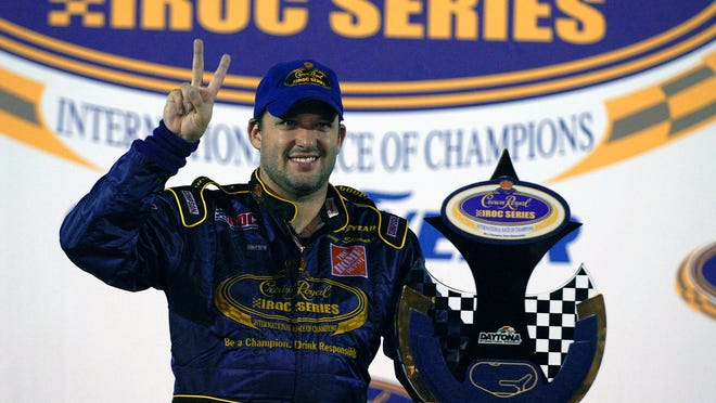 FILE - In this June 26, 2006, file photo, Tony Stewart poses with the trophy after winning the Crown Royal IROC auto race in Daytona Beach, Fla. The IROC Series, where the best drivers from various disciplines raced each other in equally prepared cars, ran for 30 seasons before Tony Stewart won its final championship in 2006 and the series quietly went away. Now Stewart, along with fellow NASCAR Hall of Famer Ray Evernham, has teamed with a group of heavyweights to bring an all-star circuit back in 2021. The Superstar Racing Experience plans a six-race, short-track series to air in prime-time on CBS in a Saturday night summer spectacular.