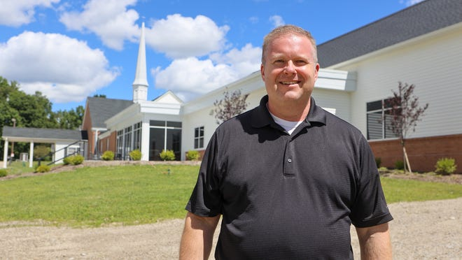 The Rev. Dr. Eric Tritten is pictured outside of the Gloria Dei Lutheran Church on Ravenna Street in Hudson. The church recently finished a $2.5 million expansion project, which includes a new 4,000 square foot Ministry Center.