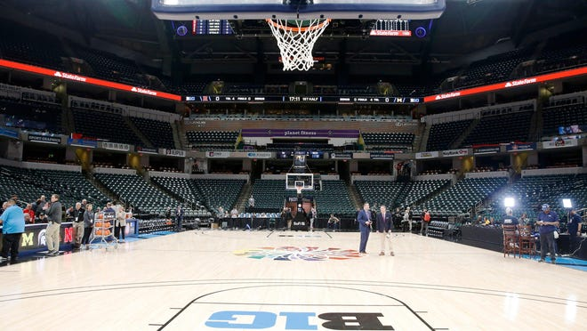 The court is cleared after the cancellation of the Big Ten Tournament at Bankers Life Fieldhouse in Indianapolis on Thursday, March 12, 2020, as athletic conferences around the country canceled tournaments in response to the spread of the COVID-19 virus. (Liz Martin/The Gazette via AP)